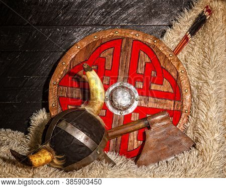 Steel Ax Horned Helmet And Wooden Viking Shield With Pattern