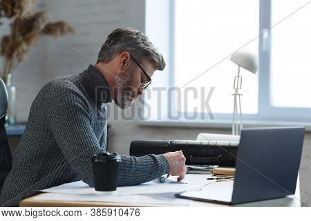 Interior Designer Working In Office With Blueprints.engineer Inspect Architectural Plan, Sketching A