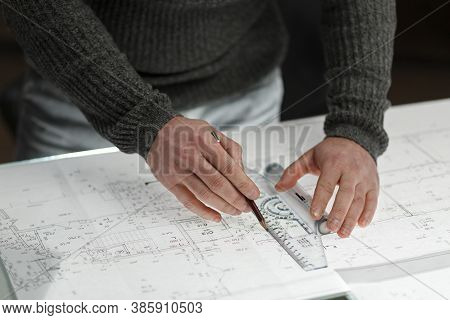 Architect Drawing Blueprints In Office. Engineer Sketching A Construction Project. Architectural Pla