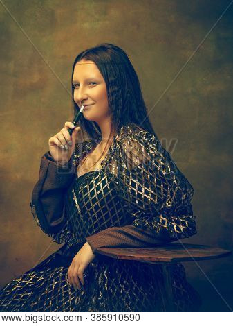 Smoking. Young Woman As Mona Lisa, La Gioconda Isolated On Dark Green Background. Retro Style, Compa