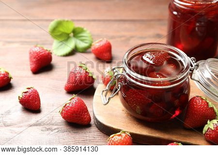 Delicious Pickled Strawberry Jam And Fresh Berries On Wooden Table