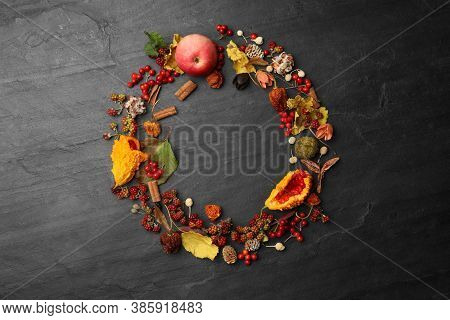 Dried Flowers, Leaves And Berries Arranged In Shape Of Wreath On Black Background, Flat Lay With Spa