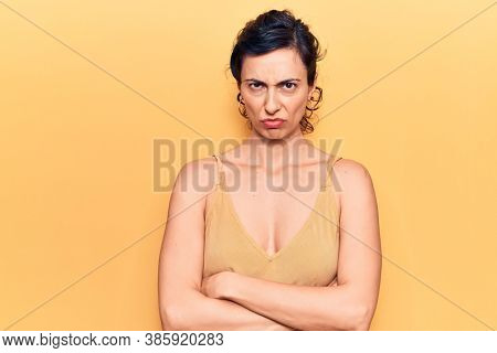 Young beautiful hispanic woman wearing casual clothes skeptic and nervous, disapproving expression on face with crossed arms. negative person.