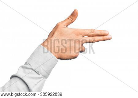 Hand of caucasian young man showing fingers over isolated white background gesturing fire gun weapon with fingers, aiming shoot symbol