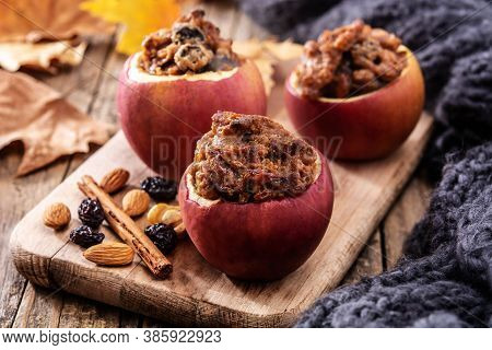 Stuffed Apples Baked With Nuts On Wooden Table.
