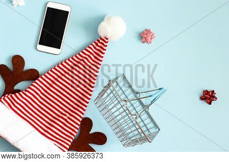 Christmas Online Shopping. Christmas Santa Hat In Red And White Stripes With Brown Elk Antlers, Next