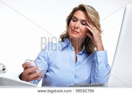 Business woman having a headache. Isolated on white background.