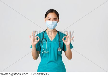 Covid-19, Coronavirus Disease, Healthcare Workers Concept. Young Professional Female Doctor, Asian I