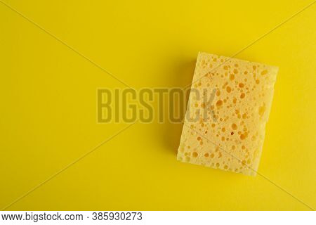 Kitchen Washcloth On Yellow Background. Sponges. Washcloths For Cleaning. Top View.