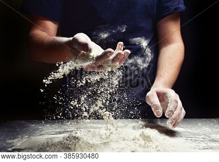Baker With Flour Sifts Through His Hand