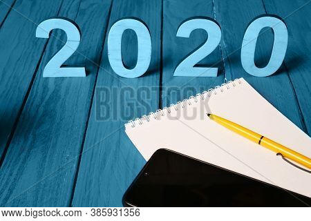 Planing Concept Idea For 2020 Year. Twenty Twenty, Smart Phone And Notebook Blank Space With Yellow