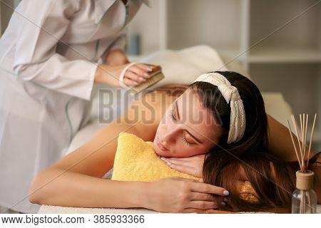 Massage And Body Care. Spa Body Massage. Woman Having Massage In Spa.