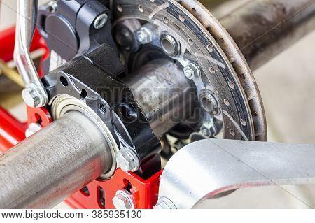 Close Up Standard Rear Axle And Bearings Wheel Hubs And Hydraulic Caliper Disc Brake Unit Of Mini Ra