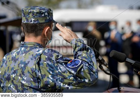 Capu Midia, Romania - September 17, 2020: Officer Of The Romanian Air Force Saluting.