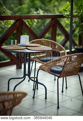 Interior Of A Summer Cafe, Rattan Furniture In A Rustic Style
