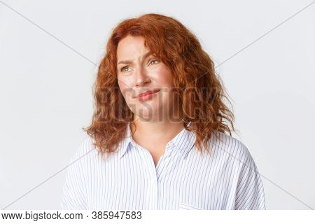 People, Emotions And Lifestyle Concept. Close-up Of Skeptical And Unamused Redhead Middle-aged Woman