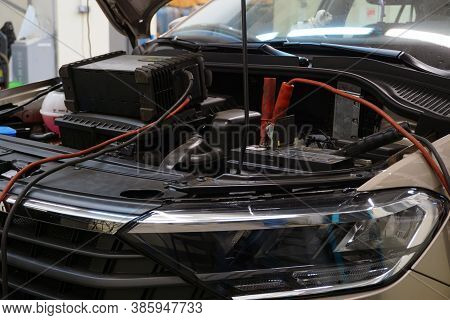 A Modern Car In A Car Service At A Diagnostic Post. The Hood Is Open On The Vehicle And Diagnostic E