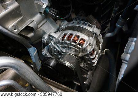 Generator (alternator) Installed In The Engine Of A Modern Car.
