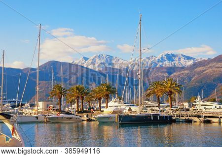 Beautiful Winter Mediterranean Landscape. Yacht  Marina At Foot Of Snow-capped Mountains. Montenegro