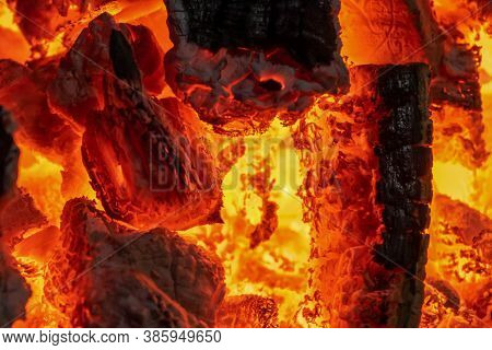 Incandescent Charcoal Embers With Beautiful Orange And Reddish Tones