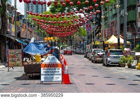 Jalan Alor Food Street In Kuala Lumpur. The Utility Vehicle Truck Displayed Warning Signs. Kuala Lum