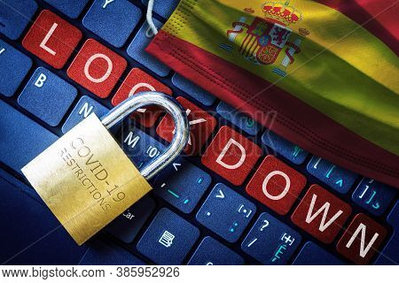 Spain Covid-19 Coronavirus Lockdown Restrictions Concept Illustrated By Padlock On Laptop Red Alert