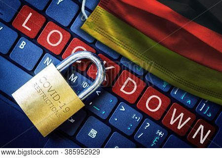 Germany Covid-19 Coronavirus Lockdown Restrictions Concept Illustrated By Padlock On Laptop Red Aler