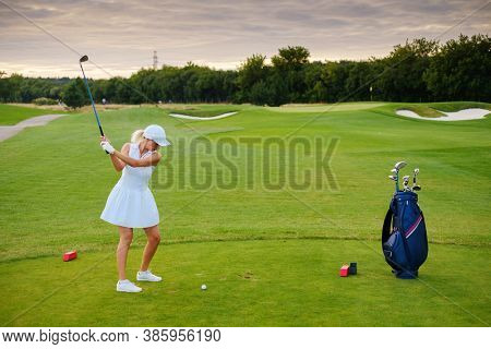 Woman Hit Ball With Golf Stick .