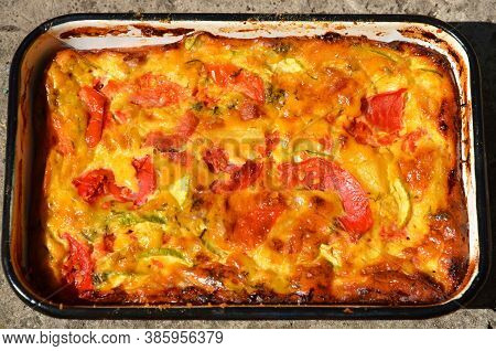 A Casserole Made With Vegetables, Eggs, Cheese And Meat.