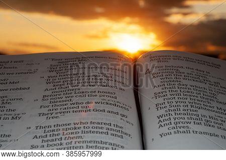 Fuji City, Shizuoka, Japan - February 2, 2020: Holy Bible Open At Sunset With Highlight On Malachi 4