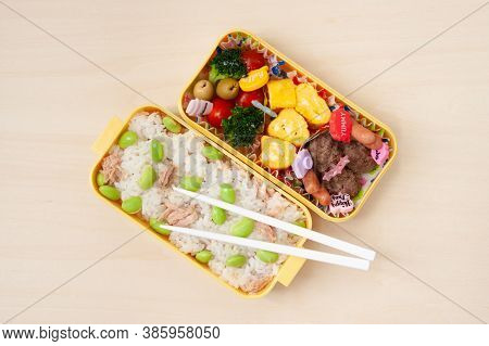 Japanese Cuisine - Top View Of Traditional Homemade Bento Box With Rice, Meat, Egg, Fish, Vegetables