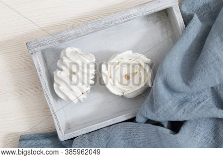 Beautifully Decorated Dessert. White Zephyr In The Shape Of Flowers On Wooden Box On Table. Beautifu