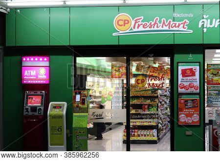 Pathum Thani, Thailand - Mar 15, 2018: In Front Of Cp Fresh Mart Shop At The Night. Green Corporate