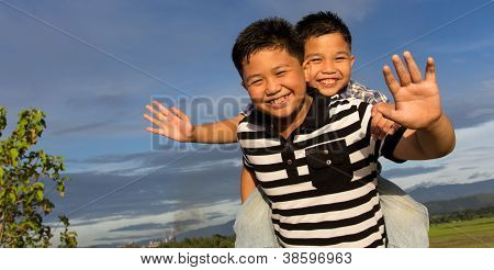 Happy sibling waving their hands
