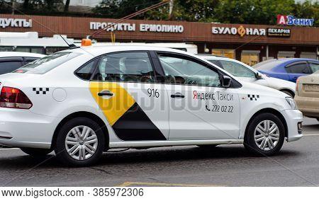 Yandex Taxi Car In A Traffic Jam On A City Street. Movement. Passenger Transport. Russia. Krasnoyars