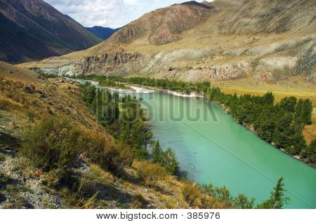 Turquoise River In The Mountains,