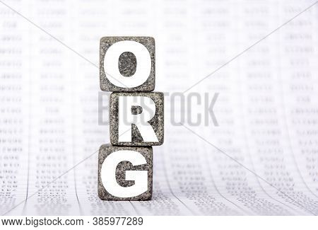 Three Stone Cubes On The Background Of White Financial Statements, Tables With The Word Org. Strong