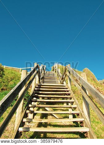 Ground View Of Wooden Beach Steps At Sandringham, Vic, Australia. The Steps Lead To A White Sandy Be