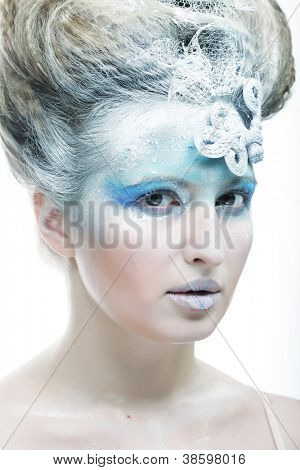 Portrait of a winter lady with creative visage