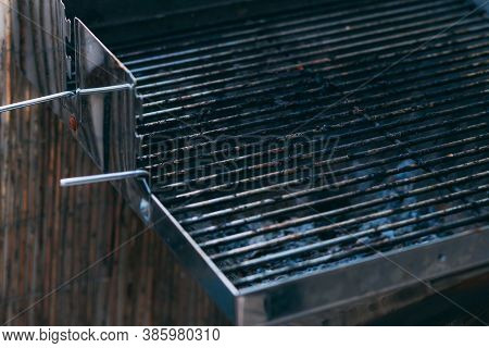 Part Of Dirty Barbecue Grill Grate After Cooking. Empty Grill Grate. Side View Of A Barbecue Grill G