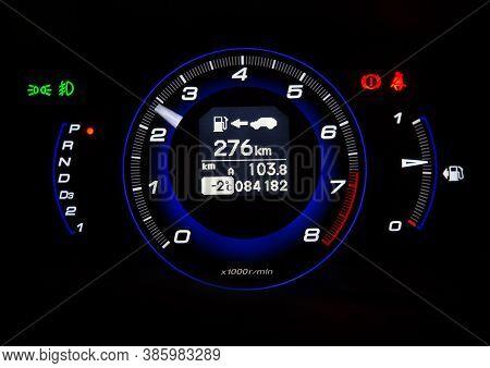 Modern Automotive Tachometer On Black Background Photo