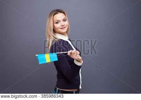 Immigration And The Study Of Foreign Languages, Concept. A Young Smiling Woman With A Sweden Flag In