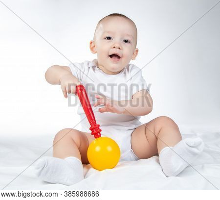 Photo Of A Eleven-month-old Baby With Rattle