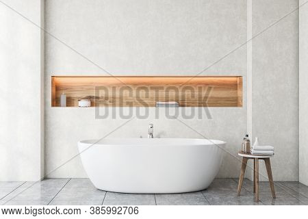 Interior Of Modern Bathroom With White Walls, Tiled Floor And Comfortable Bathtub. 3d Rendering