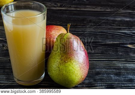 A Glass Of Pear Juice And Juicy Pears On A Dark Wooden Background Close Up Copy Space
