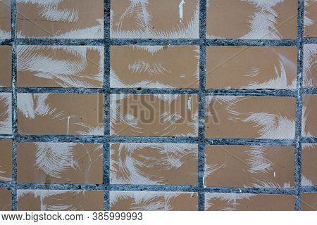 Background Of Brown Ceramic Tiles, Stained With White Paint. Full Frame Image Of Brown Ceramic Tile