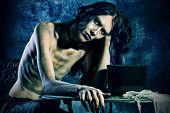 Gloomy vampire sitting at the night background. Halloween. poster