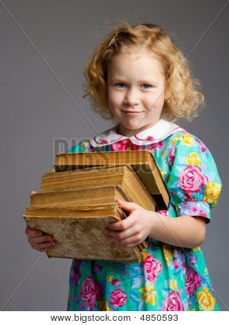 Preschool Girl Carrying Books