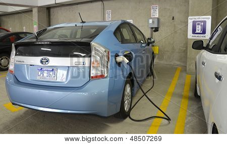 Electric Car Charging At Charging Station