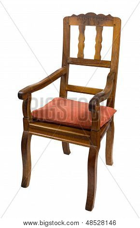 antique armchair made of walnut wood from the biedermeier time